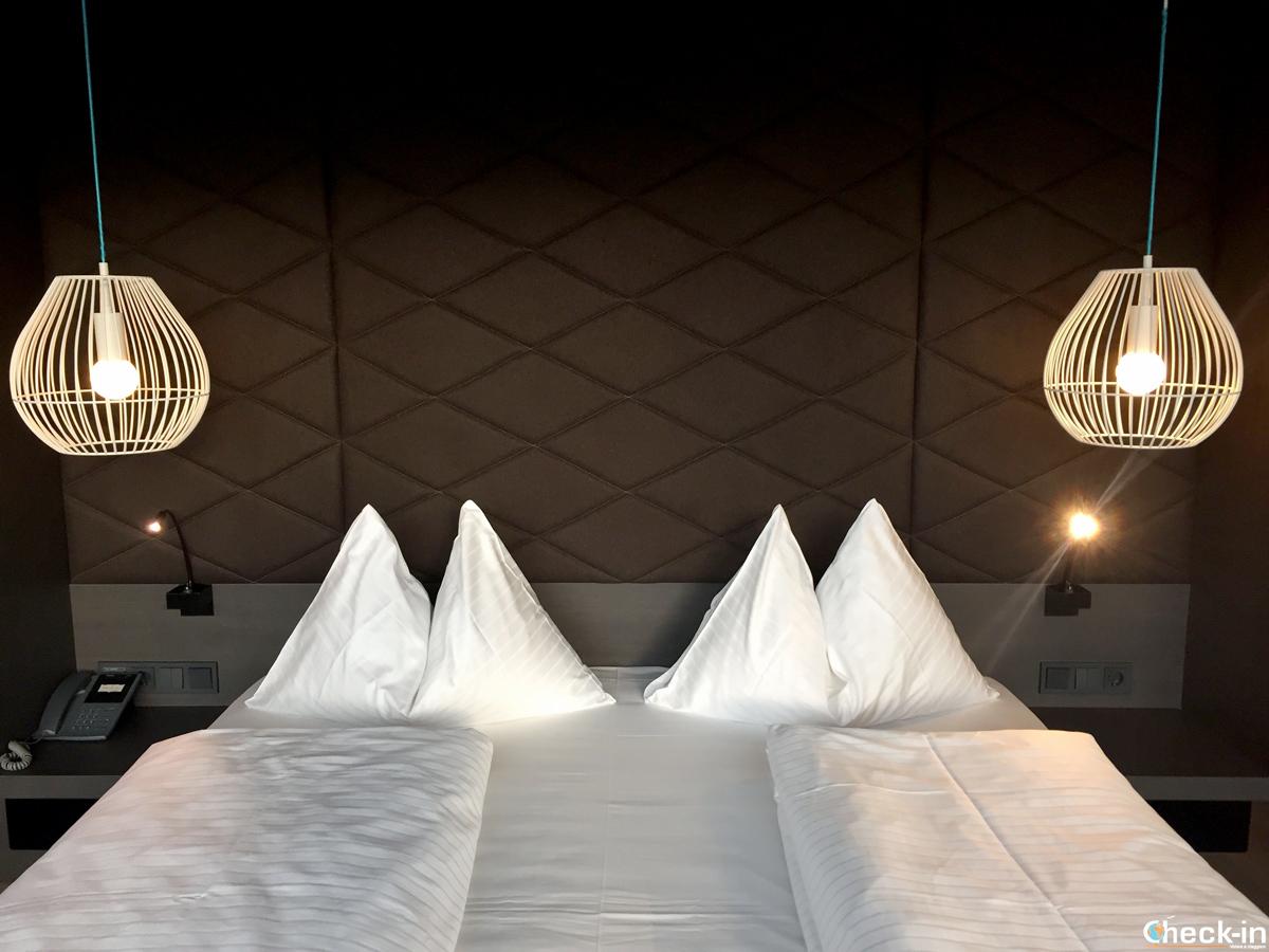 Camera da letto dell'aDLERS Hotel di Innsbruck - Tirolo, Austria